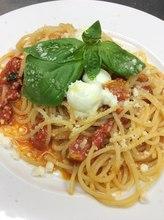 Pasta with tomato sauce, mozzarella, and basil
