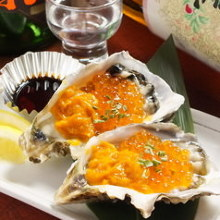 Raw oysters topped with sea urchin and salmon roe