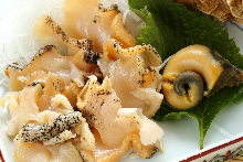 Whelk sauteed with garlic butter