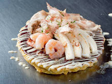 Pork, squid, and shrimp okonomiyaki