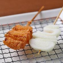 Fried onion skewer