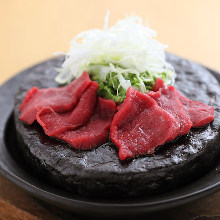Seared wagyu beef on stone grilled bowl