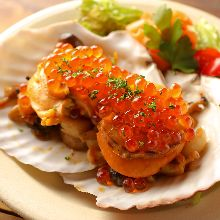 Grilled mushrooms and scallops with butter