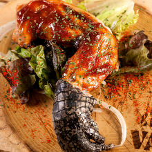 Grilled crocodile meat with garlic