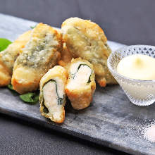 Marinated deep-fried chicken tenderloin and pickled plum rolled in perilla leaf