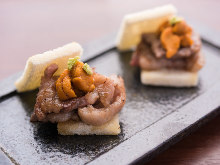 Seared beef topped with sea urchin