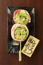 Grilled pork wrapped lettuce skewer