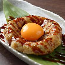 Meatballs served with egg yolk