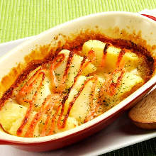 Grilled potatoes and marinated cod roe with cheese