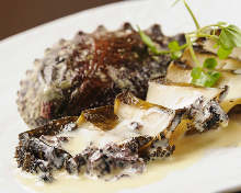 Abalone steak with laver seaweed, cream, and abalone liver sauce