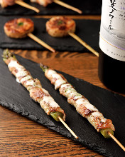 Pork wrapped asparagus skewer