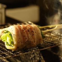 Grilled pork wrapped lettuce skewer