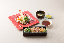 Tempura and steak over rice in a laquered box with tempura set