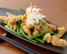 Salted and stir-fried chicken neck with green onion