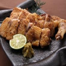 Grilled locally raised chicken thigh with rock salt