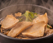 Rosy seabass and salted seaweed takikomi gohan (mixed rice) in an earthenware pot
