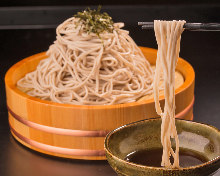 Wild yam buckwheat noodles served on a bamboo strainer with agodashi (flying fish broth) soup