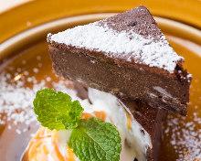 Burdock root chocolate cake with caramel sauce on soy milk cream
