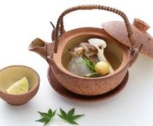 Matsutake steamed in an earthenware teapot