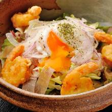 Caesar salad with shrimp fritters and duck