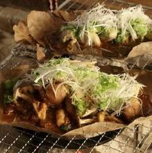 Grilled fresh fish on magnolia leaf