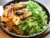 Oyster Hiroshima-style okonomiyaki topped with green onions