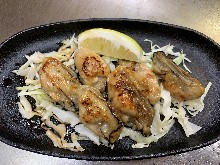 Grilled oysters with butter